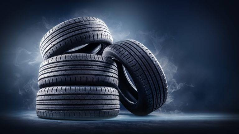 Stack of tyres on black background